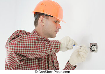 man installing electrical box - Construction worker...