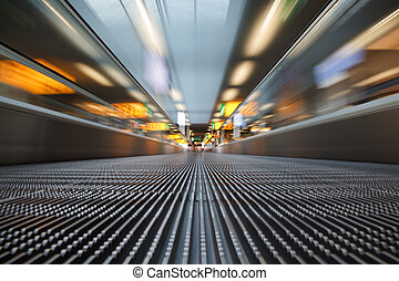 Airport escalator - A people mover conveyor belt on the...