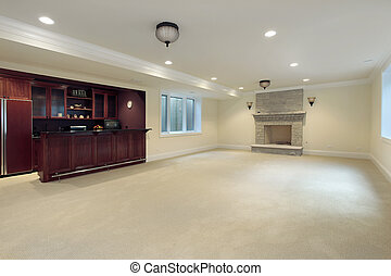 Basement with fireplace and bar - Basement in new...