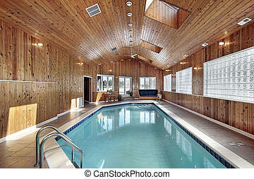 Swimming with wood paneled ceiling