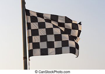 Checkered Flag and blue sky photo