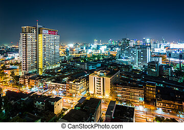 View of the Ratchathewi District at night, in Bangkok, Thailand.