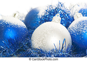 Blue and silver christmas balls isolated on a white...