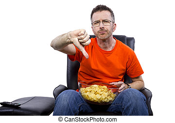Front View of Man Watching TV with Snacks - Front view of...