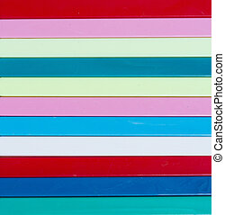 Colorful striped background. Plastique sticks of different...