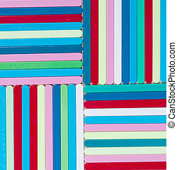 Colorful striped background Plastique sticks of different...