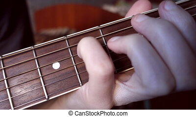 Hand clamped chords on the fingerboard - White hand clamped...