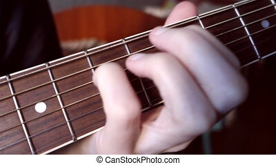 Fingers clamped chords on the fingerboard - white fingers...