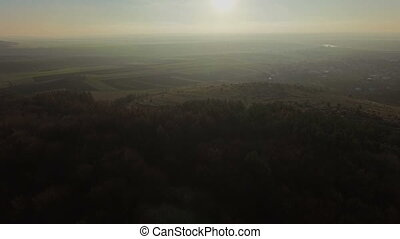 Aerial view of mountainous terrain at sunset HD