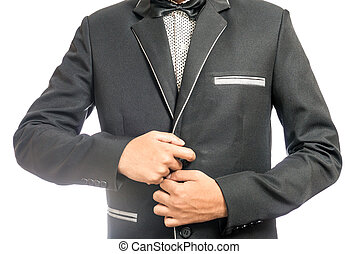 man adjusting his suit - A young business man adjusting his...