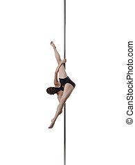 Studio shot of flexible girl dancing on pole