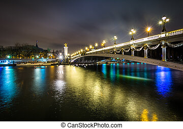 Pont Alexandre III and the Seine at night, in Paris, France.