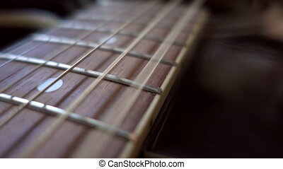 Vibrating strings closeup - The strings vibrate at an...