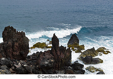 saint kitts - black rocks at atlantic ocean, saint kitts and...