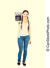 Young woman hold digital calculator.