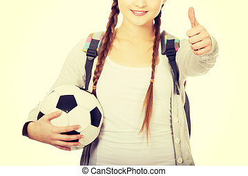 Young woman with foot ball - Teenager with foot ball and...