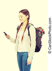 Teen with backpack sending sms - Happy school girl texting...