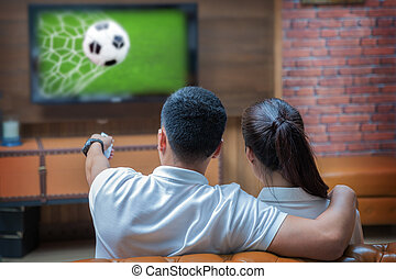 Football match and remote control - Sweet fsmily with...