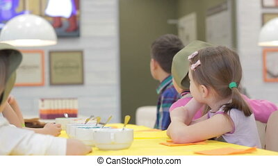 Children watching television cartoons Full HD