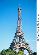 summer day the sun shines over the Eiffel Tower symbol of...