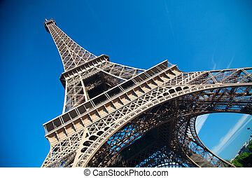 summer day the sun shines over the Eiffel Tower symbol of Paris. Travel to Europe