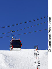 Gondola and chair-lifts at ski resort in nice day. Caucasus...