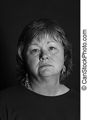 Sober Lady - a sad looking middle aged lady in black and...