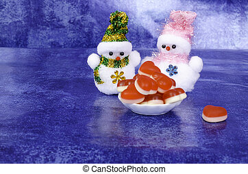 Two snowmen  with red hearts.