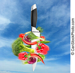 Healthy eating - Big chief knife with vegetables round it -...