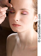 Makeup - Stylist causes make up the beautiful model
