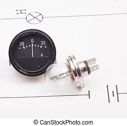 Ammeter and  and  automobile lamp  on a background of the electric scheme