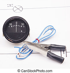 Ammeter and electric clamps  on a background of the electric scheme