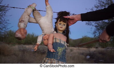 Doll Horror Beating With Stick - Chilling scene of toy dolls...
