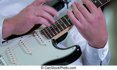 Professional Musician Playing Guitar - CLOSE UP:...