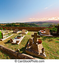 Churchyard on the Background of the Tuscan Landscape at...