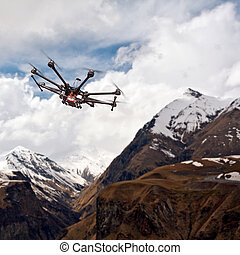 Octocopter, copter, drone - Copter flying over mountainous...