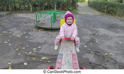 little girl on a swing on a sunny autumn day. Full HD