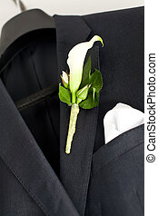 Suit for wedding - Suit jacket hanging on a hanger with a...