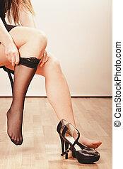 Woman wearing black stockings