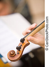 womens hand on the neck of violin