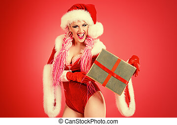 humorous - Pretty sexual babe dressed as Santa Claus posing...