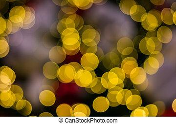 Defocused ligths of golden Christmas tree