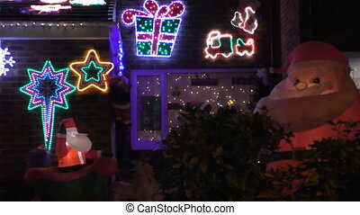 House Christmas outdoor decorations - Lights flashing and...