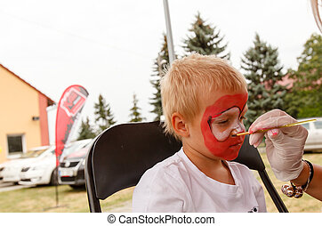 little boy and body painting shallow DOF