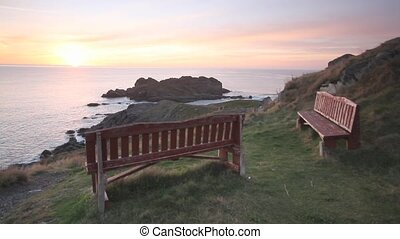 Benches at sunrise - Benches near the ocean at sunrise.