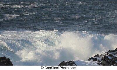 Waves breaking - Waves crashing on rocks.