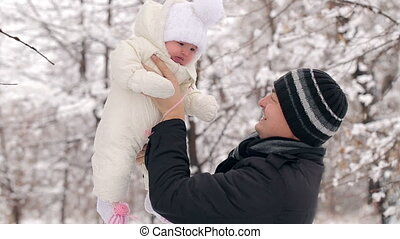 Father With Child in Winter - father with his little...