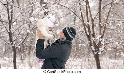 Father With Daughter in Winter - father with his little...