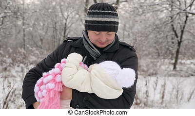 Father Lulls Baby - father lulls baby in winter