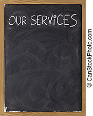our services blackboard sign - our services - white chalk...